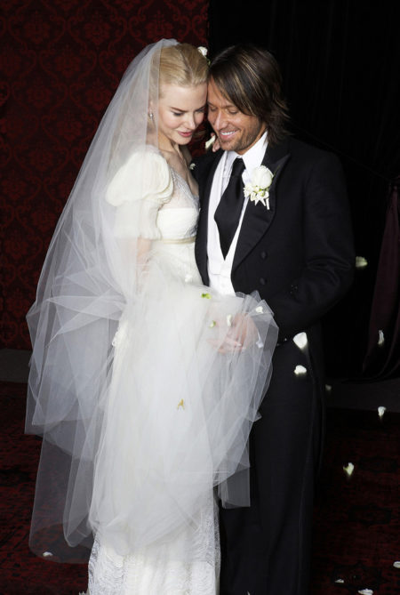 """Jun 26,  2006 - Manly,  Sydney,  AUSTRALIA - NICOLE KIDMAN,  39 and KEITH URBAN were married in a candlelight ceremony at Cardinal Cerretti Memorial Chapel,  230 guests. Kidman married country crooner,  shunning Hollywood glitz for a fairytale ceremony at a clifftop chapel in her hometown of Sydney attended by close family and just a smattering of A-list stars,  such as Russell Crowe - one of four Oscar winners in attendance,  along with Kidman,  the director Jane Campion and the designer Catherine Martin,  wife of Baz Luhrmann - spoke at the reception. A-List Guests include: Hugh Jackman and Deborra-Lee Furness,  Russell Crowe and Danielle Spencer,  Baz Luhrmann and Catherine Martin,  Naomi Watts. From the happy couple: """"We just want to thank everyone in Australia and around the world who have sent us their warm wishes."""" Also as at request of Nicole & Keith: In Good faith we ask that anyone who publishes this photograph make a donation to the Sydney Children's Hospital,  Randwick. Contact: Elizabeth Crundall: CEO Sydney Children's Hospital Foundation,  Locked Bag 5,  Randwick,  NSW,  2031,  Australia. Mandatory Credit: Photo by Cath Muscat/ZUMA Press. (©) Copyright 2006 by Cath Muscat"""