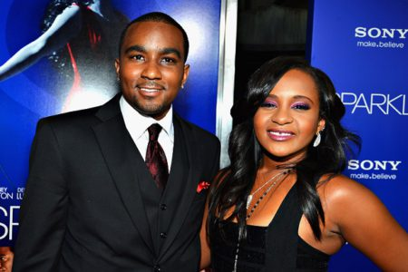 """HOLLYWOOD,  CA - AUGUST 16: Bobbi Kristina Brown (R) and Nick Gordon arrive at Tri-Star Pictures' """"Sparkle"""" premiere at Grauman's Chinese Theatre on August 16,  2012 in Hollywood,  California. (Photo by Frazer Harrison/Getty Images)"""