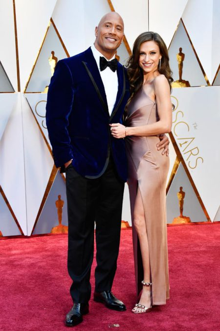 HOLLYWOOD,  CA - FEBRUARY 26: Actor Dwayne Johnson (L) and Lauren Hashian attend the 89th Annual Academy Awards at Hollywood & Highland Center on February 26,  2017 in Hollywood,  California. (Photo by Frazer Harrison/Getty Images)